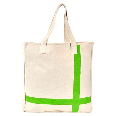 Tote your books, laptop, and more in this stylish canvas tote, showcasing a chic crossed stripe motif.   Product: Tote