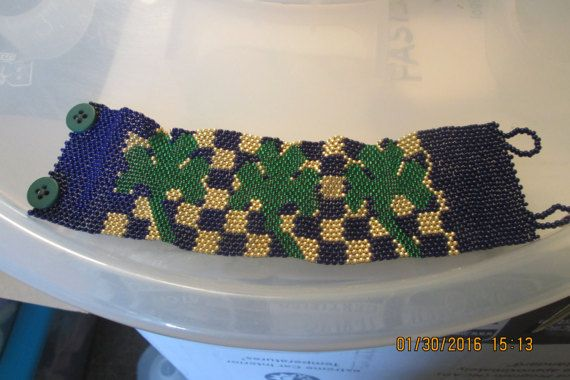 Blue and gold checkered with green shamrock by BraceletswaMission