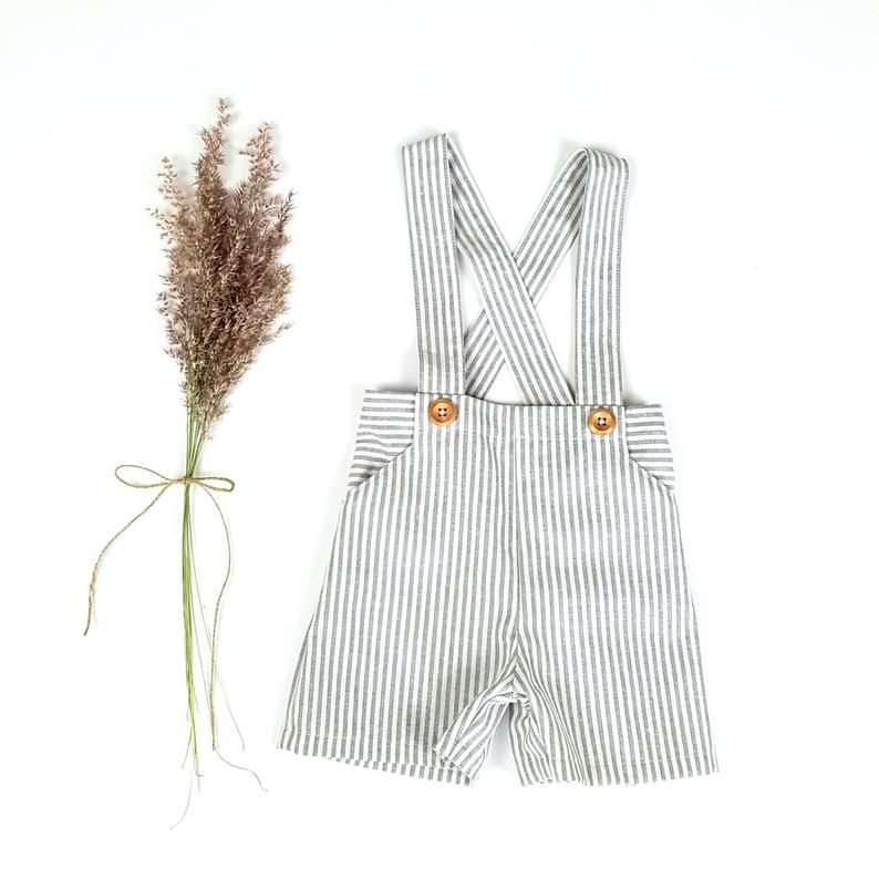 The grey and off white striped linen pants with suspenders make the perfect outfit for page boys, special occasions and photo shoots. I cut and sew each of these shorts with suspenders from a beautiful linen cotton blend fabric in a gorgeous earthy coloured pinstripe. This fabric is easy to care for and softens more with each wash. The adjustable straps ensure the perfect fit with plenty of growing room for your little one