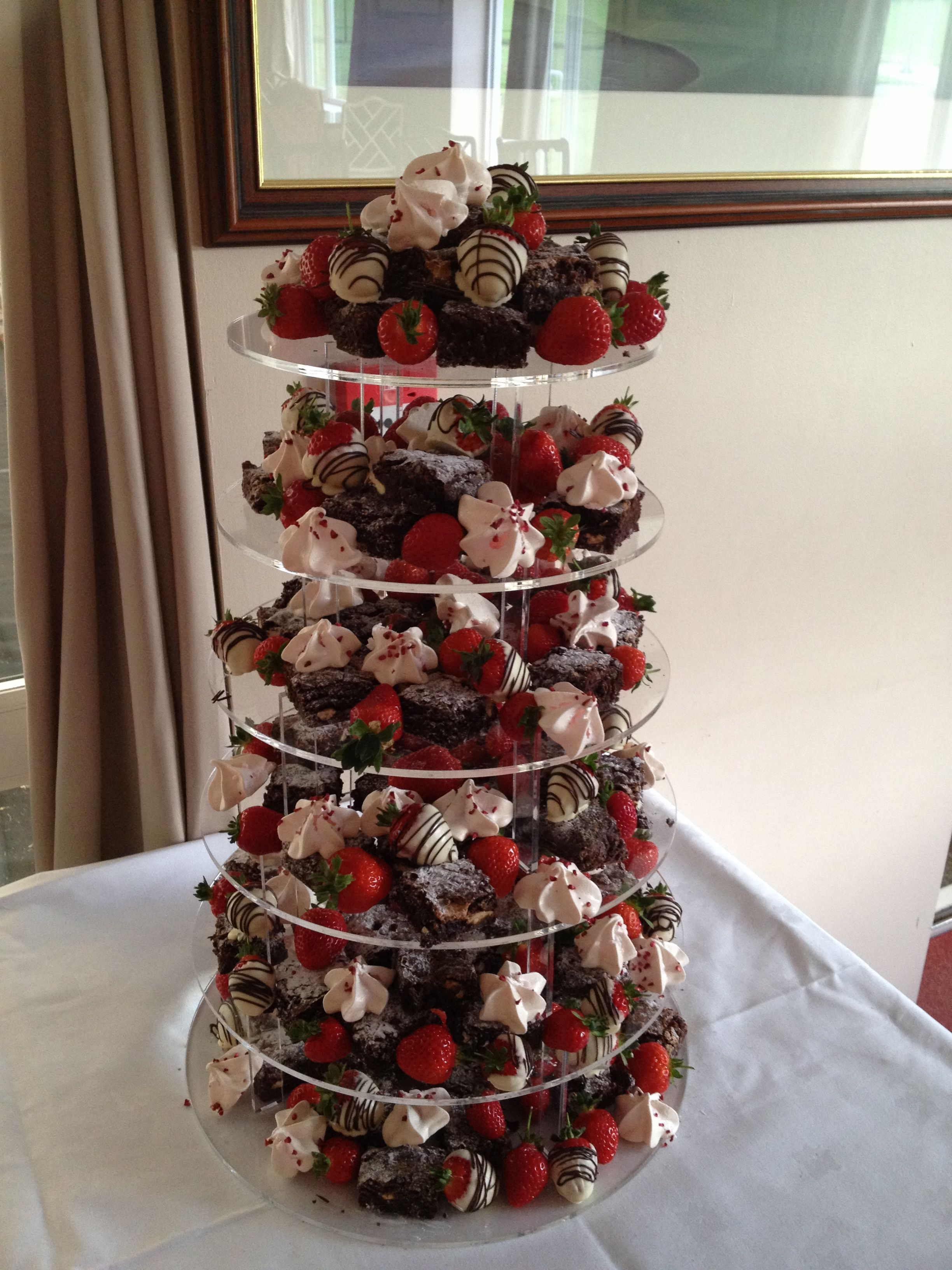 Chocolate brownie tower dotted with meringue kisses and ...
