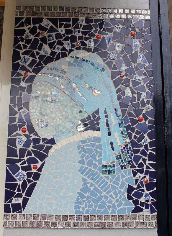 Time for another Where Oh Where Wednesday ! I spied this fun mosaic wall at the Centraal train station for today's city in the Netherlands. How many images will it take for you to guess the city?