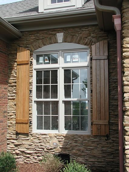 Arch Top Board And Batten Shutters Stained Shutters Exterior Window Shutters Exterior Architecture Exterior