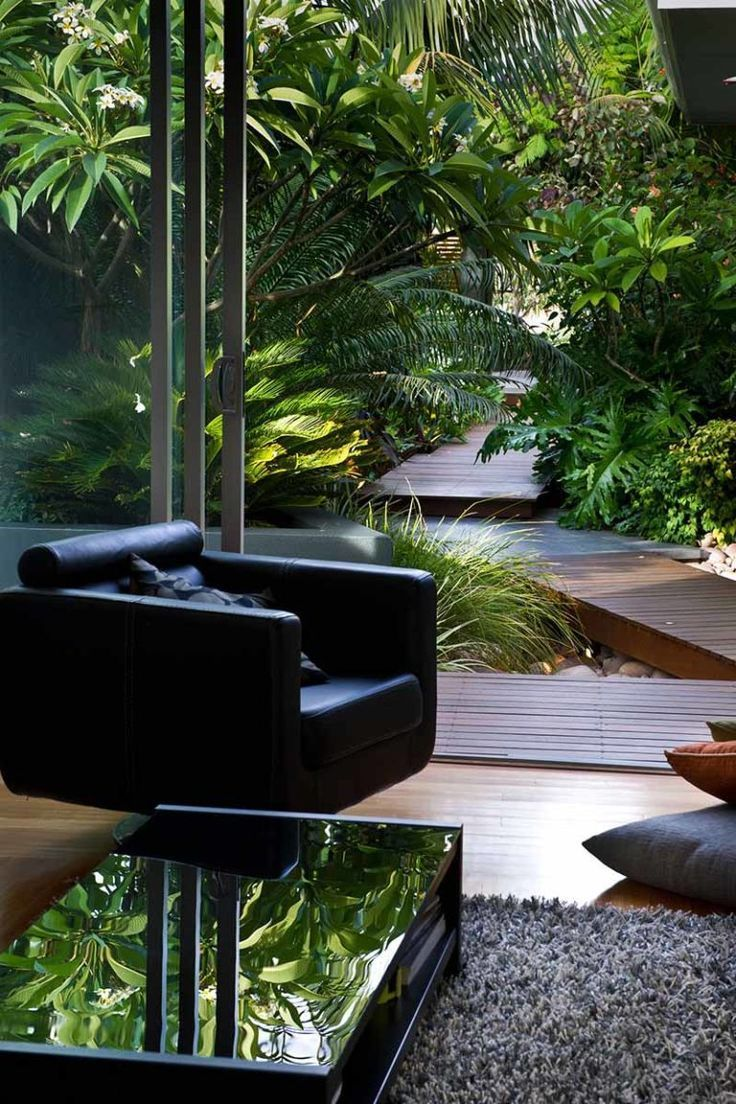 Photo of black chair with view of tropical garden, #looking #garden #with #black #chair …