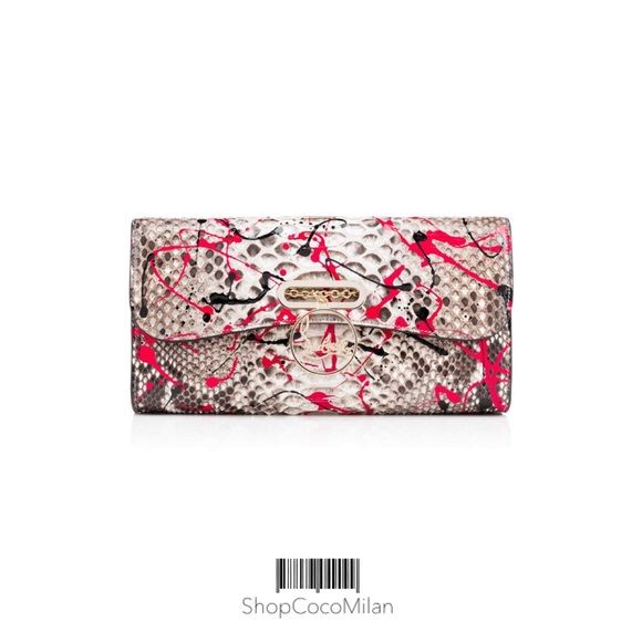 """Christian Louboutin Riviera Clutch Python Vulcano """"Riviera Clutch"""" may have been inspired by the ladies of the Côte d'Azur, but her appeal has a much wider reach. This exquisite evening bag in breathtaking fushia """"Python Vulcano,"""" with her signature Louboutin logo clasp, is a must-have for Louboutin ladies everywhere. Color : Fushia. Material : Python. Dimensions : 150mm x 260mm x 50mm. Lining : Red Grosgrain.   Please see my listing for the matching """"Lady Peep"""" heels. Christian Louboutin…"""