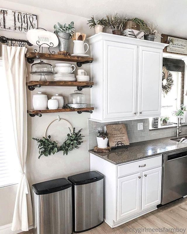 This farmhouse kitchen is so cute! We love this decor!