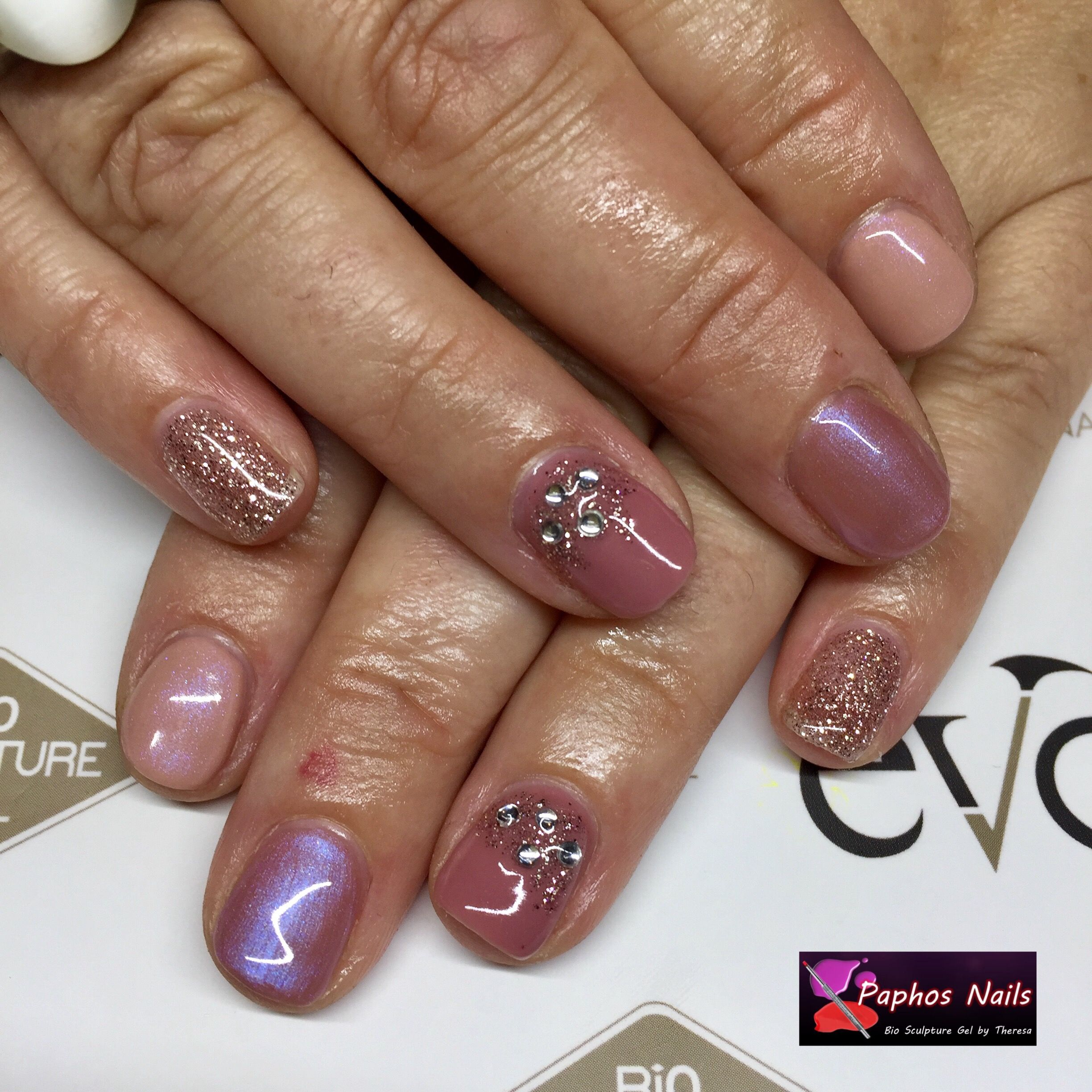 Lovely colour combination with #glitter and #gems #magicalmerrygoround #shimmeringjoy #shinelikeadiscoball #soprano #paphosnails #biosculpturebytheresa #kissonerganails