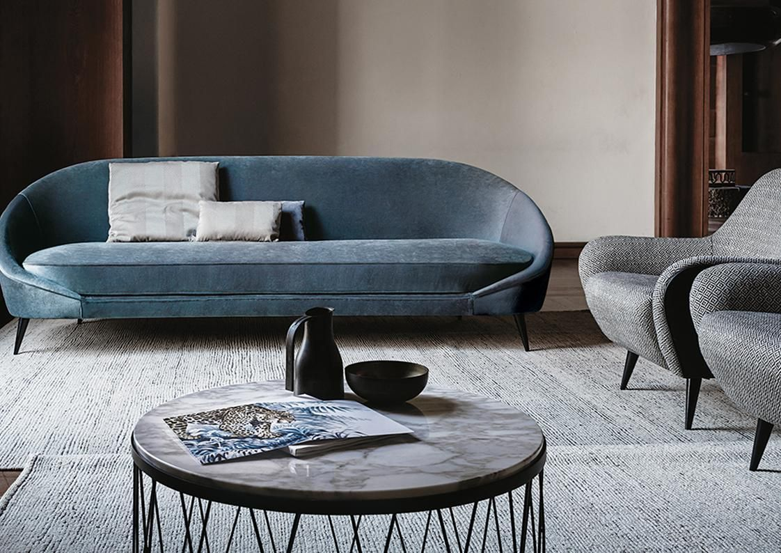 The NidoSeriesis a particularly embracing and cozy design, it's rigorous and basic lines and predominant smooth curves make it an easy choiceto complement both traditional and contemporary environments. Available in two sofa sizes and matching chair in several Italian fabrics + leathers.