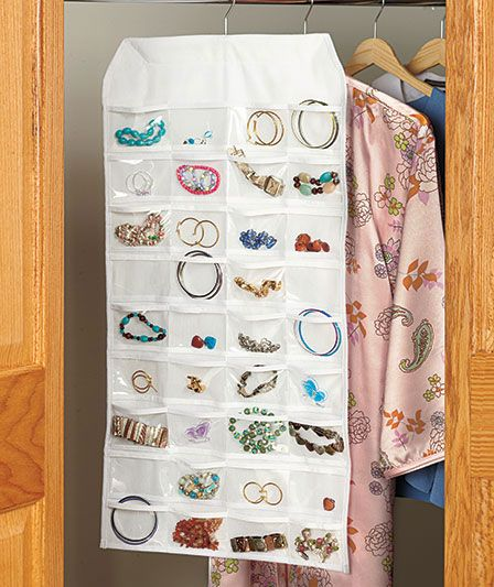 Save space with a twosided Hanging Jewelry Organizer A hanger at