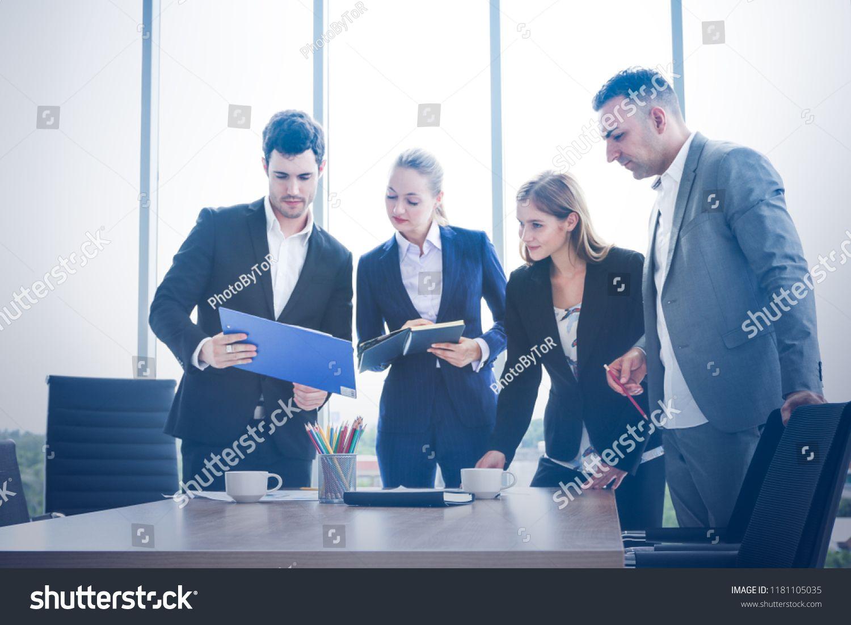 Business People Standing And Brainstorming In Workshop Meeting