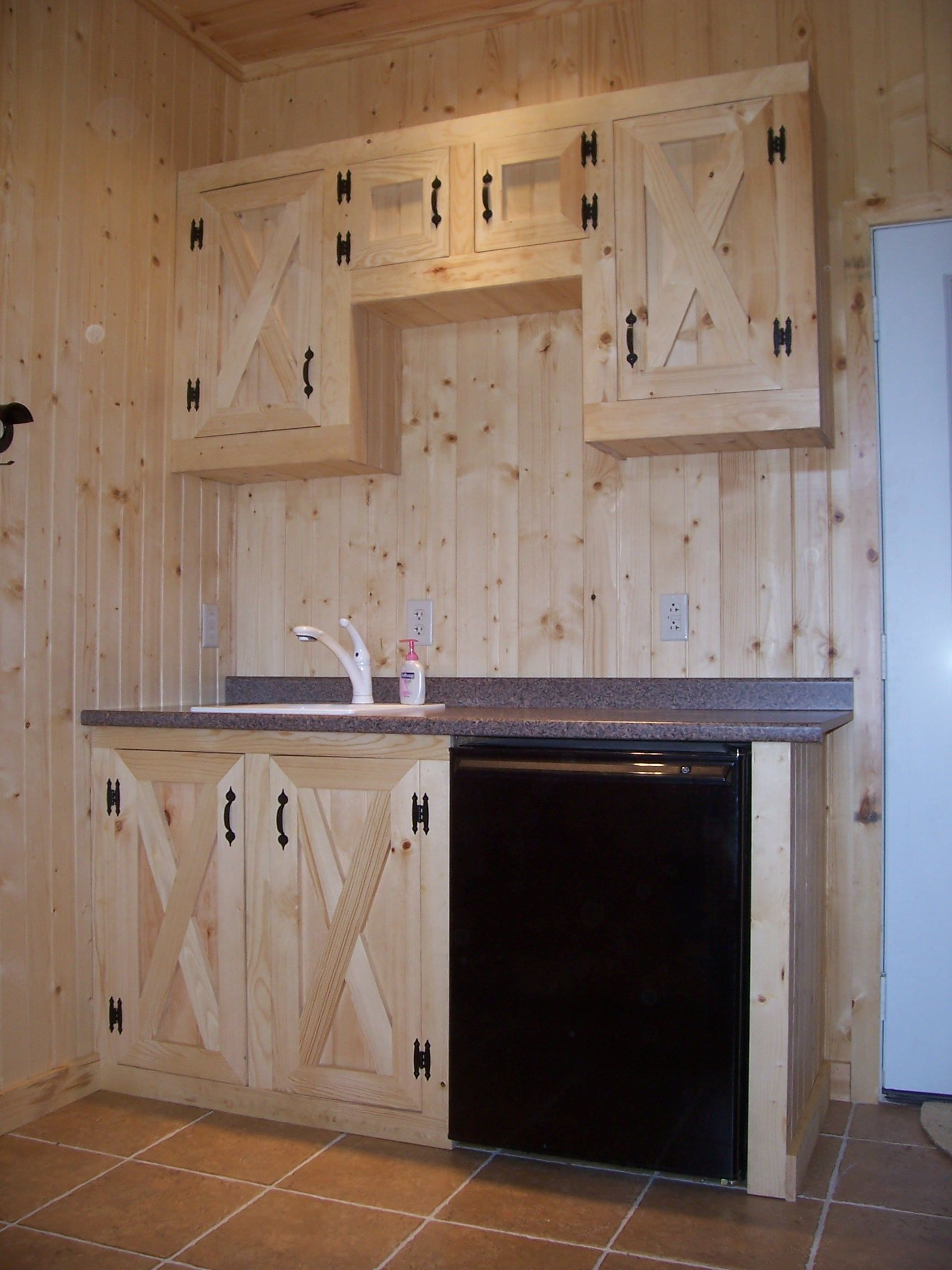 P This Tack Room Features Custom Pine Cabinets A Tile Floor Sink Barn Door Cabinet Tack Room Rustic Kitchen Cabinets