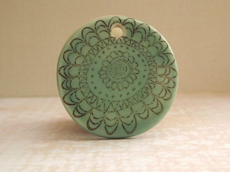 Green Flower Pendant Porcelain Ceramic. $10.00, via Etsy.