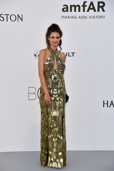 7787c8e1d39 US actress Tiffany Brouwer poses as she arrives for the amfAR s 24th Cinema  Against AIDS Gala