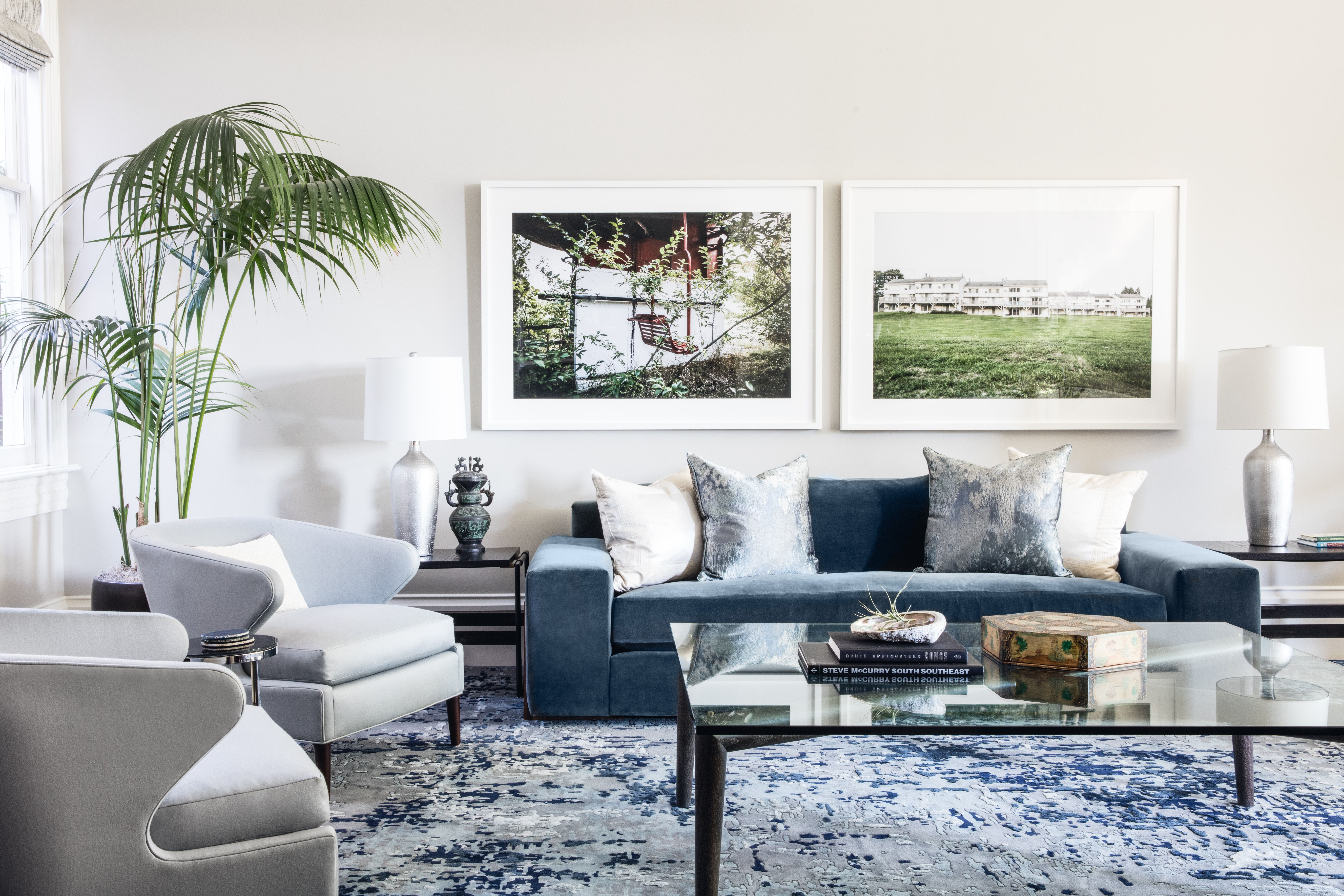 Contemporary Living Room In Shades Of Blue With Oversized Glass Coffee Tabl Contemporary Decor Living Room Contemporary Living Room Living Room Sets Furniture