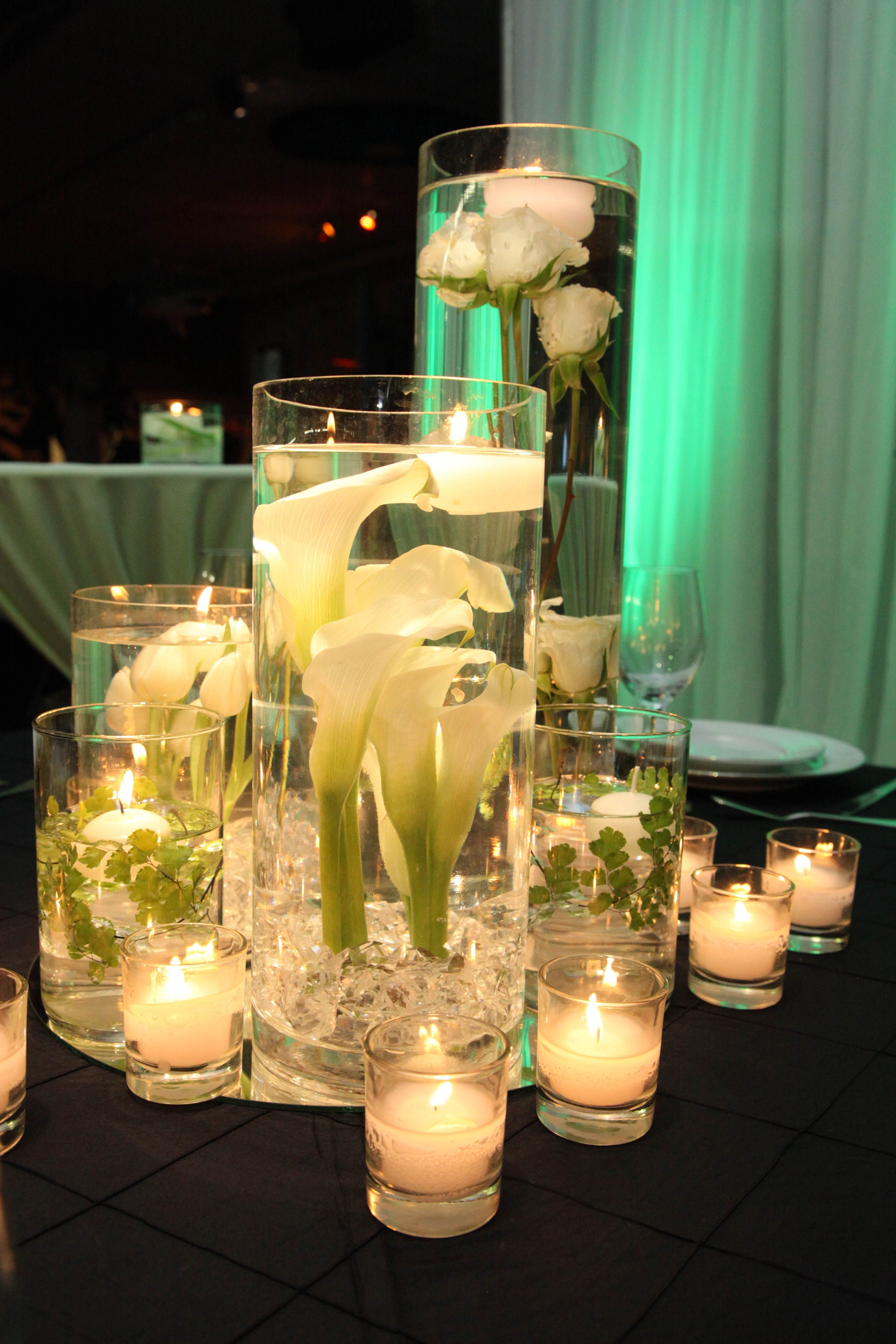 White and green color scheme cluster of glass cylinders