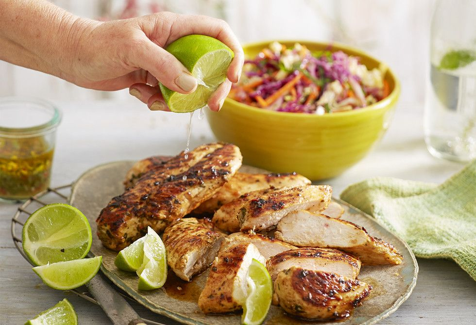 Lime and chilli flavours pair like magic in this beautiful marinated chicken dish. With a minty carrot and cabbage slaw, it's great for summer dinners outdoors.