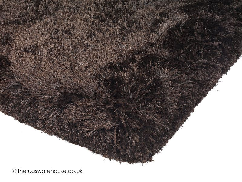 Plush Choco Rug (texture close up), a shiny super heavy & thick luxury plain shaggy rug (hand-tufted, 100% polyester, available in 5 sizes) http://www.therugswarehouse.co.uk/brown-rugs/plush-choco-rug.html #rugs