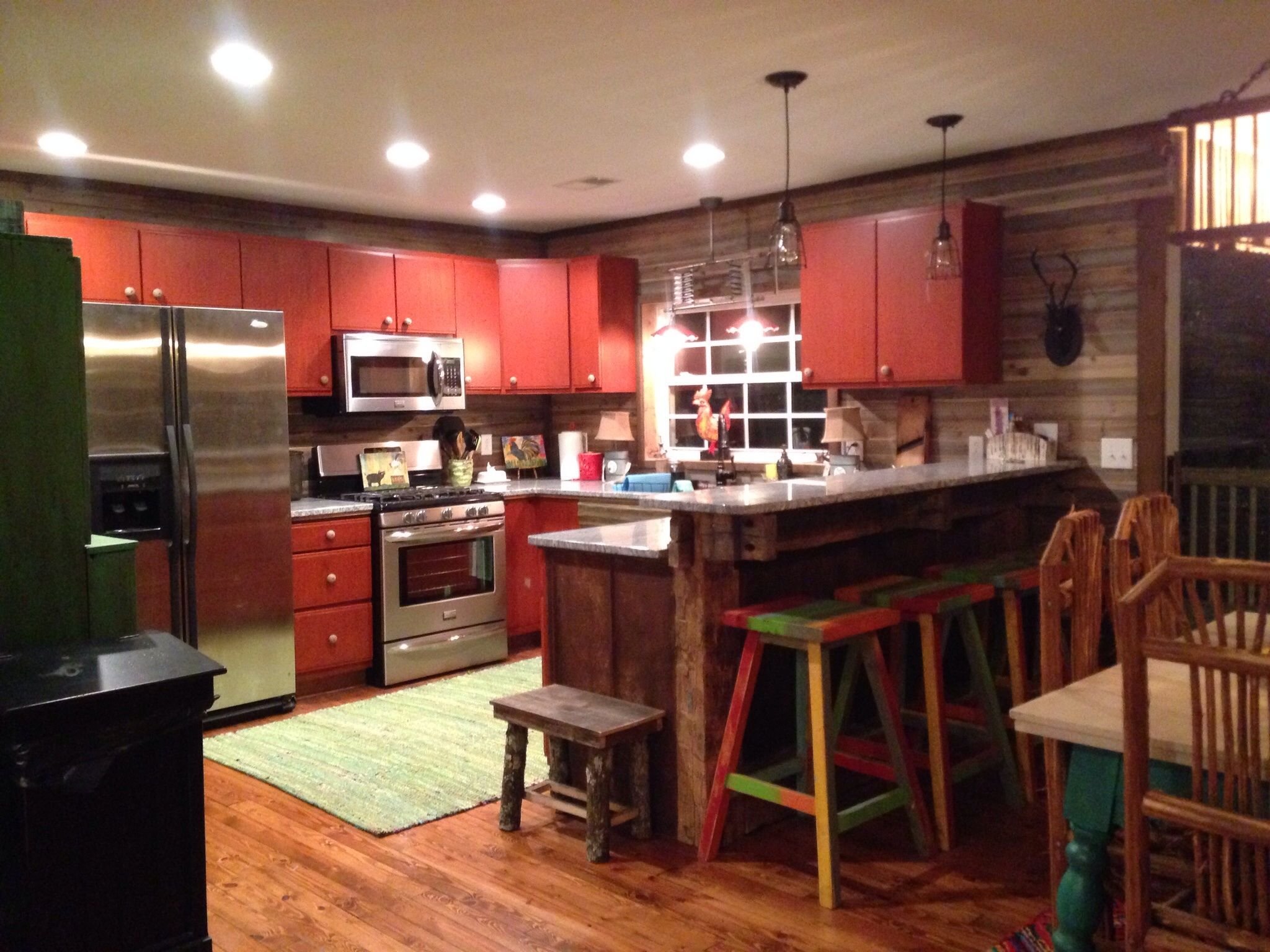 Kitchen old beams supporting bar and countertops are granite from ...
