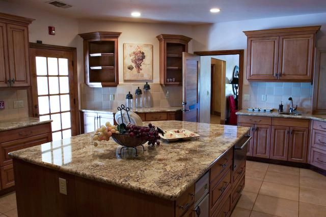 Betularie Granite With Medium Oak Cabinets