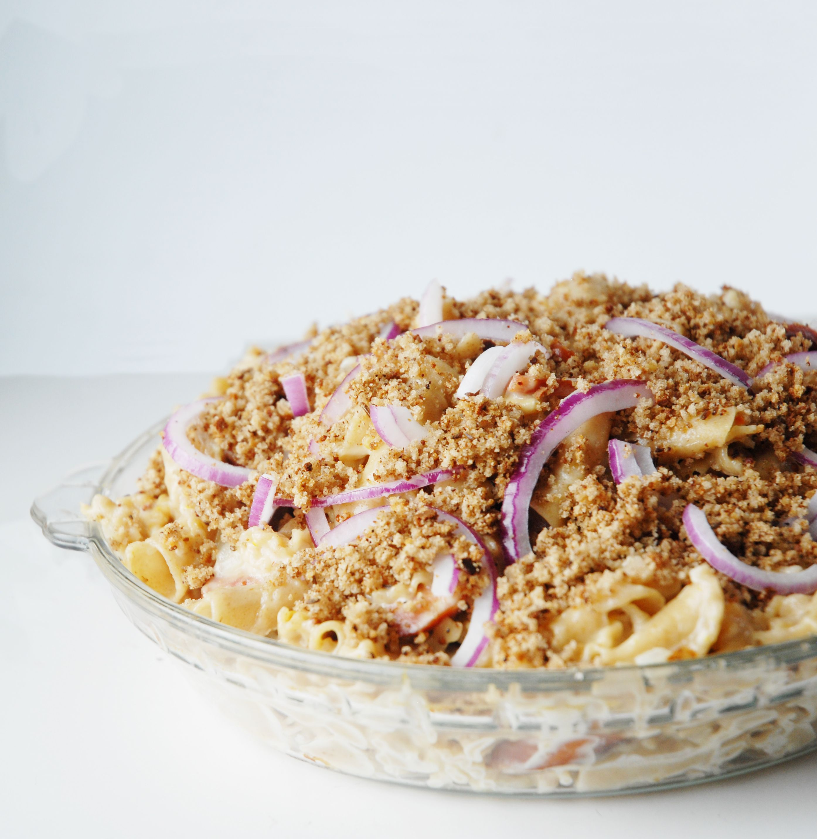 Wisconsin limburger mac n cheese with bratwurst, red onions, and rye bread crumbs