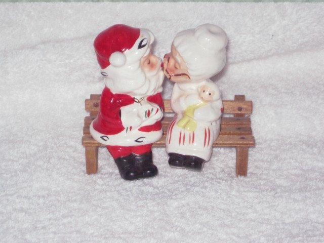 Vintage Christmas Kissing Santa and Mrs Claus on bench Salt & Pepper Shakers Figurine Napco Ornament Decoration Japan. $25.00, via Etsy.