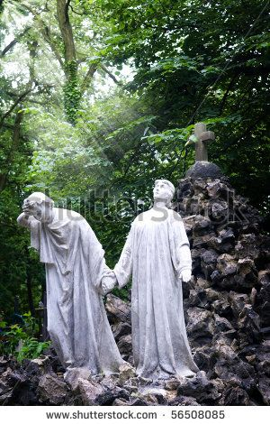 Sculpture on an old cemetery. A symbol: the hope and hopelessness go together.