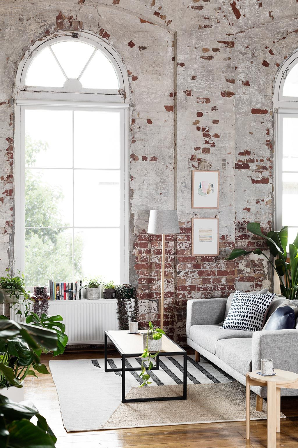 Loft interior mid century modern interior design boho style bricks interior houseplants