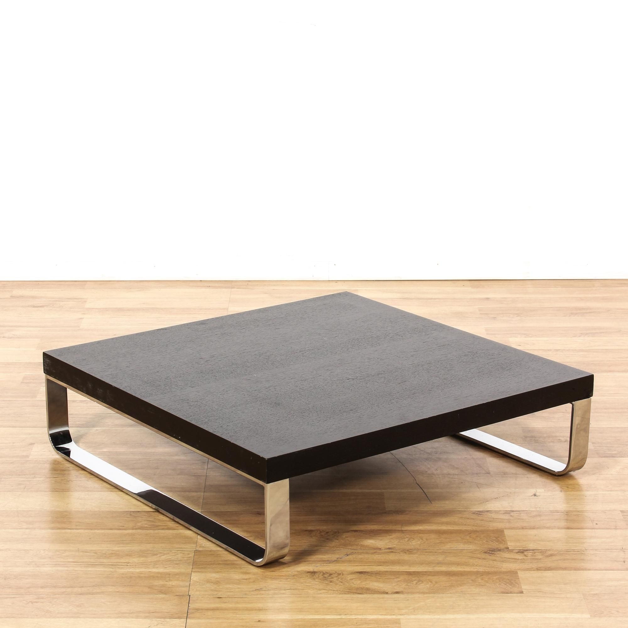 This Contemporary Coffee Table Is Featured In A Wood With A Black