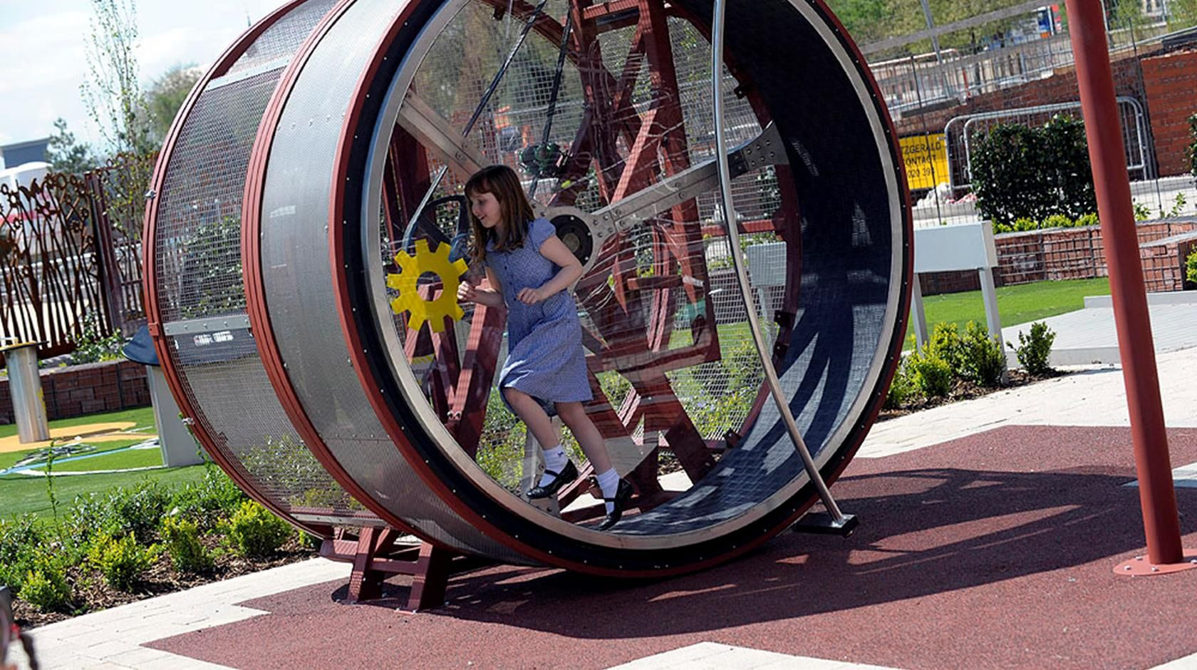 A Child Enjoying Spinning Around The Huge Human Sized Hamster