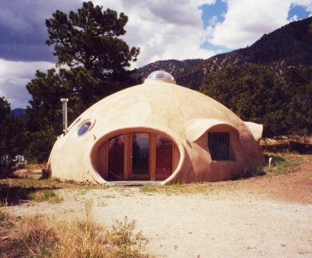 Monolithic domes are constructed by laying a concrete ring foundation, inflating an airform, coating its interior with three inches of polyurethane foam, attaching a gridwork of steel rebar, and covering the rebar and polyurethane with three inches of shotcrete, a sprayed concrete.