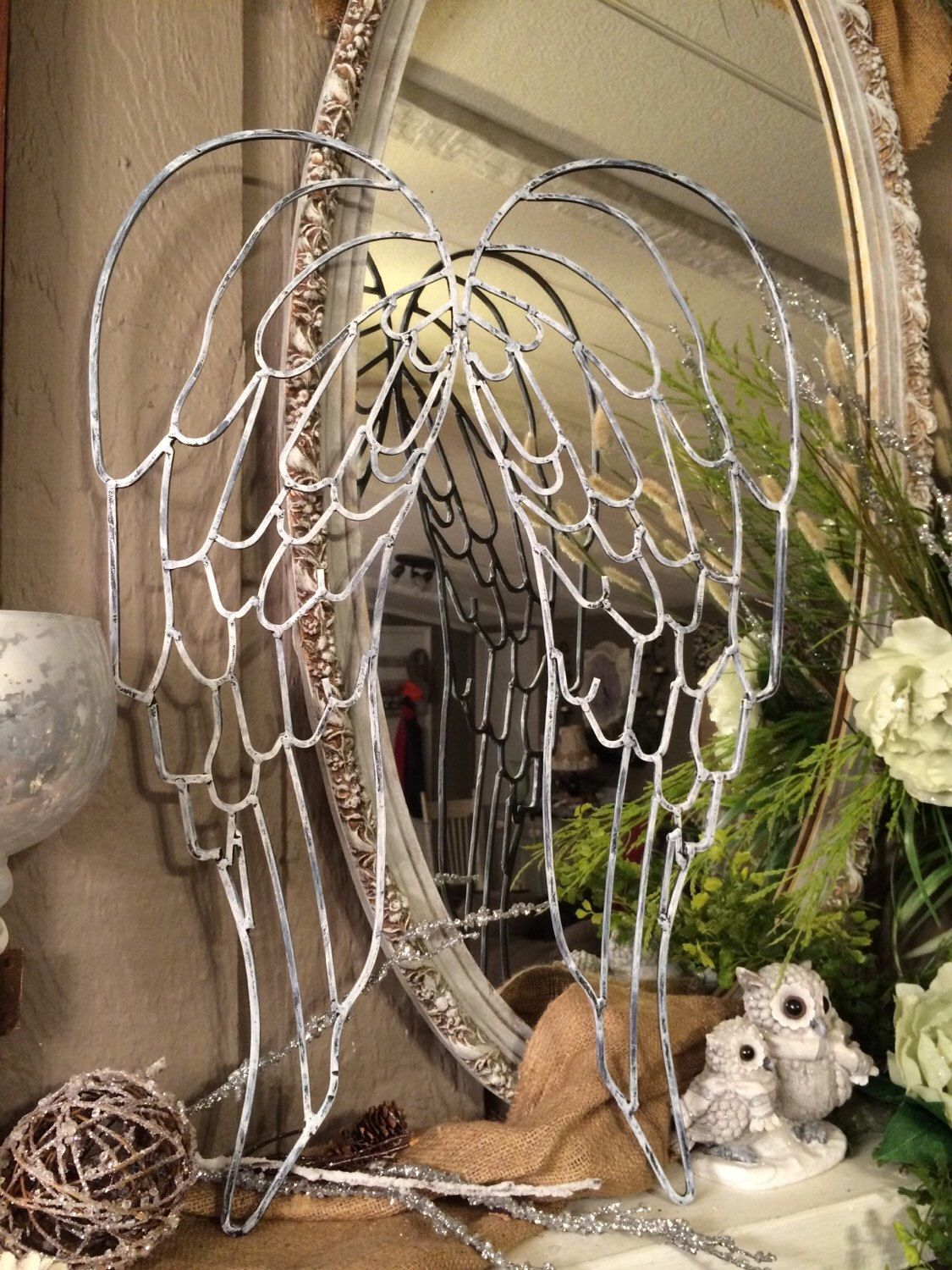 A personal favorite from my Etsy shop https://www.etsy.com/listing/219288386/white-washed-metal-angel-wings