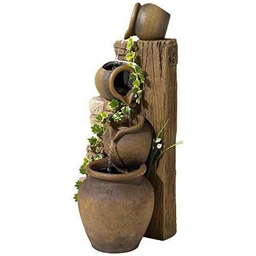 Three Rustic Jugs Cascading Fountain  Three spouted water jugs fountain are tipped to pour their contents into one another for a soothing, natural display. Rustic pillars in varied heights display the jugs. Stone finish. Cast resin construction. For outdoor/indoor use. Three rustic jugs fountain. Water cascades down three levels. Stone finish. Cast resin construction. For outdoor/indoor use. Includes fountain water pump. 9-foot cord plugs into any standard wall outlet. 14″ wide. 13″ ..