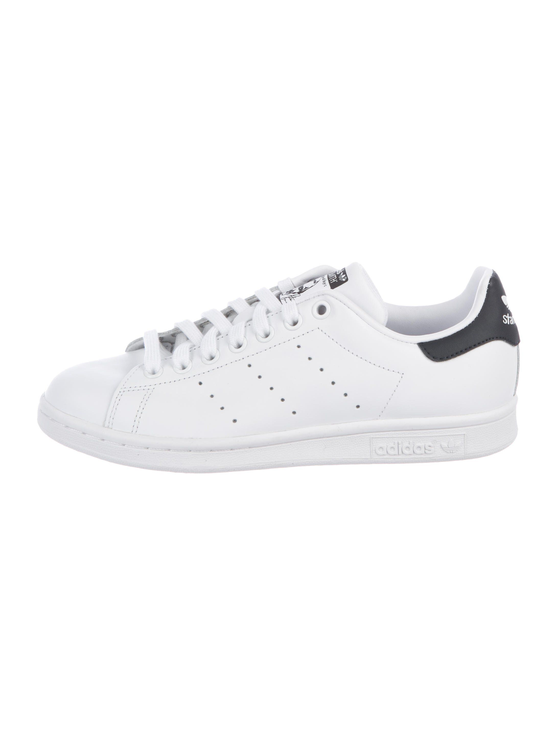 3cc2bdcb7092 Mens  white leather Adidas Stan Smith low-top sneakers with perforated  stripe embellishments at sides