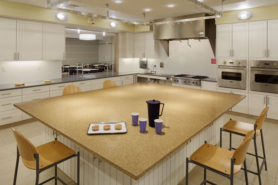 This Commercial Kitchen Was Designed To Have A More Residential Feel. The  Large Center Table And Ample Circulation Provides Room For Cooking Classes.