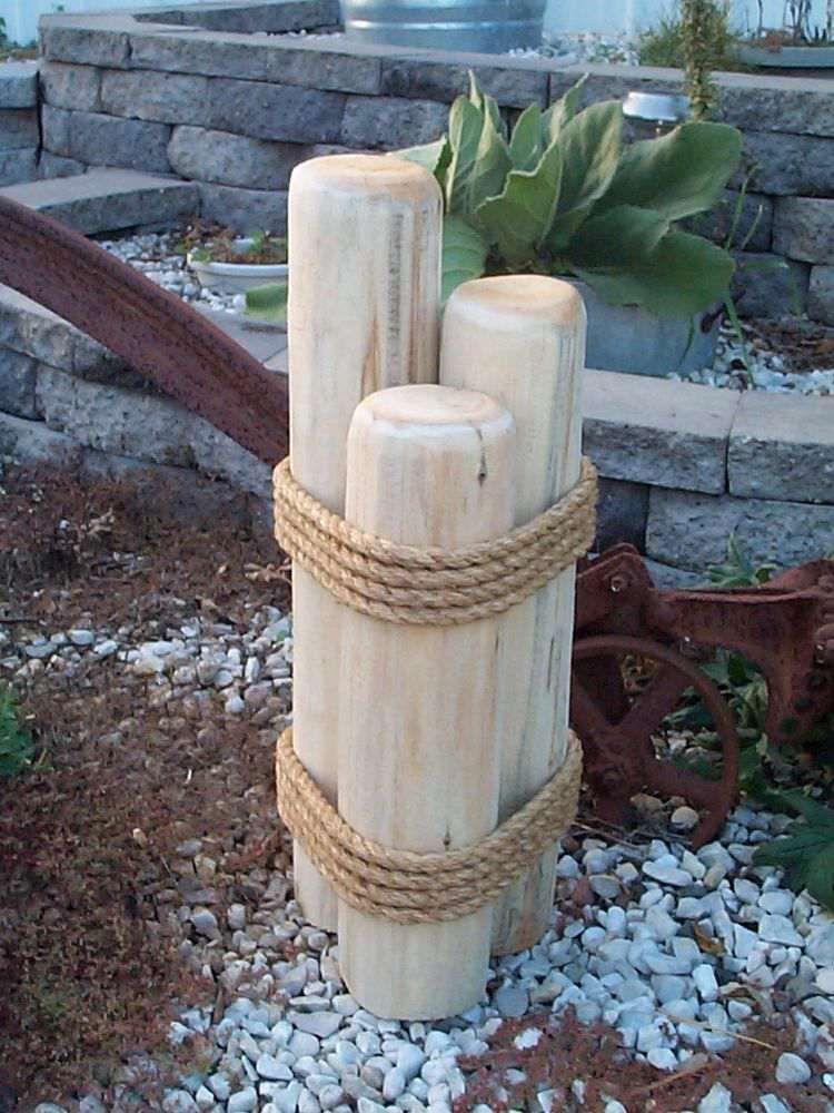 d677b498f934d décor de jardin esprit bord de mer à faire soi-même- poteaux d amarrage en  bois et corde
