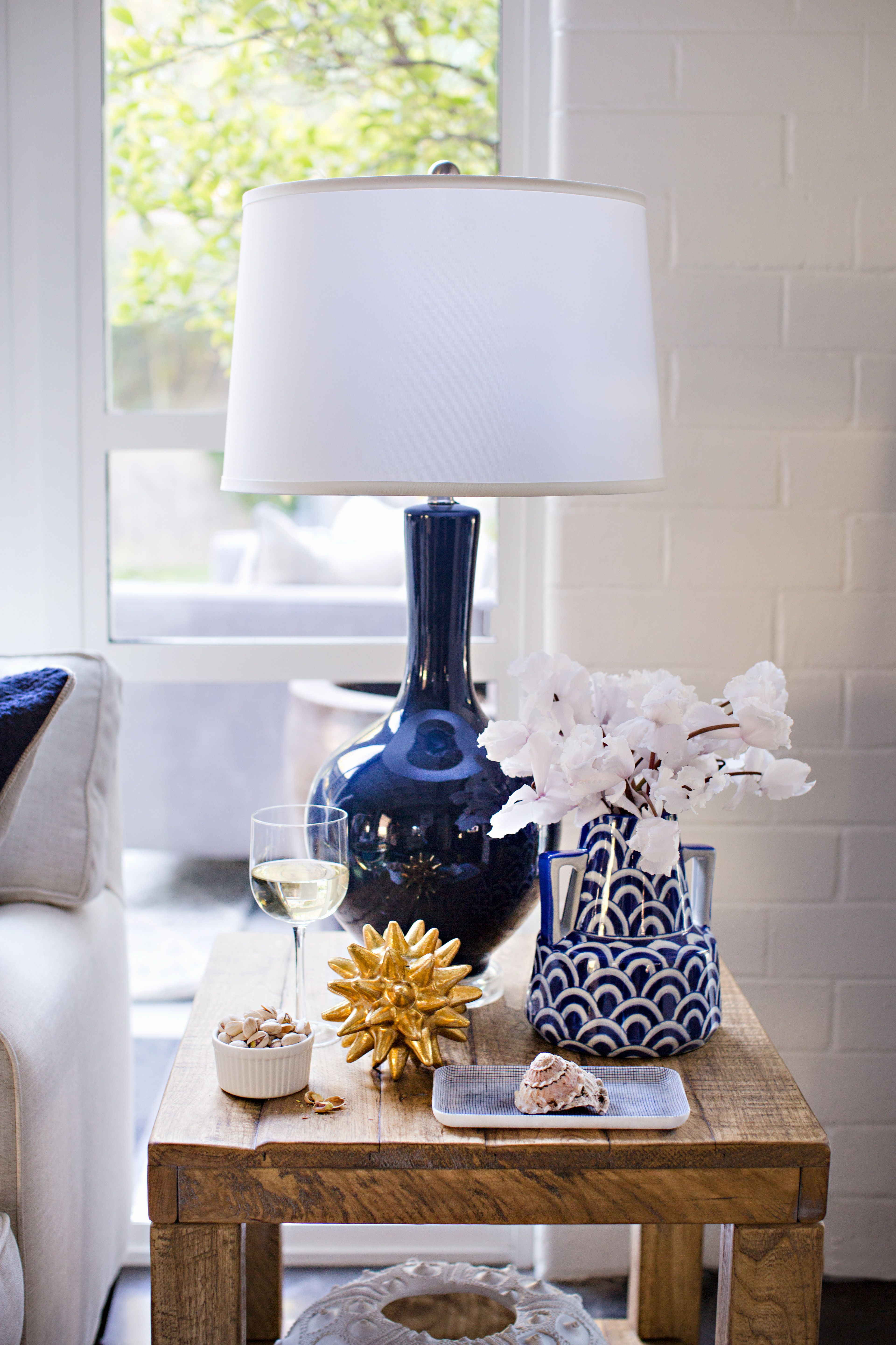 33h 130 add some height and color to your end table with the sloane navy lamp