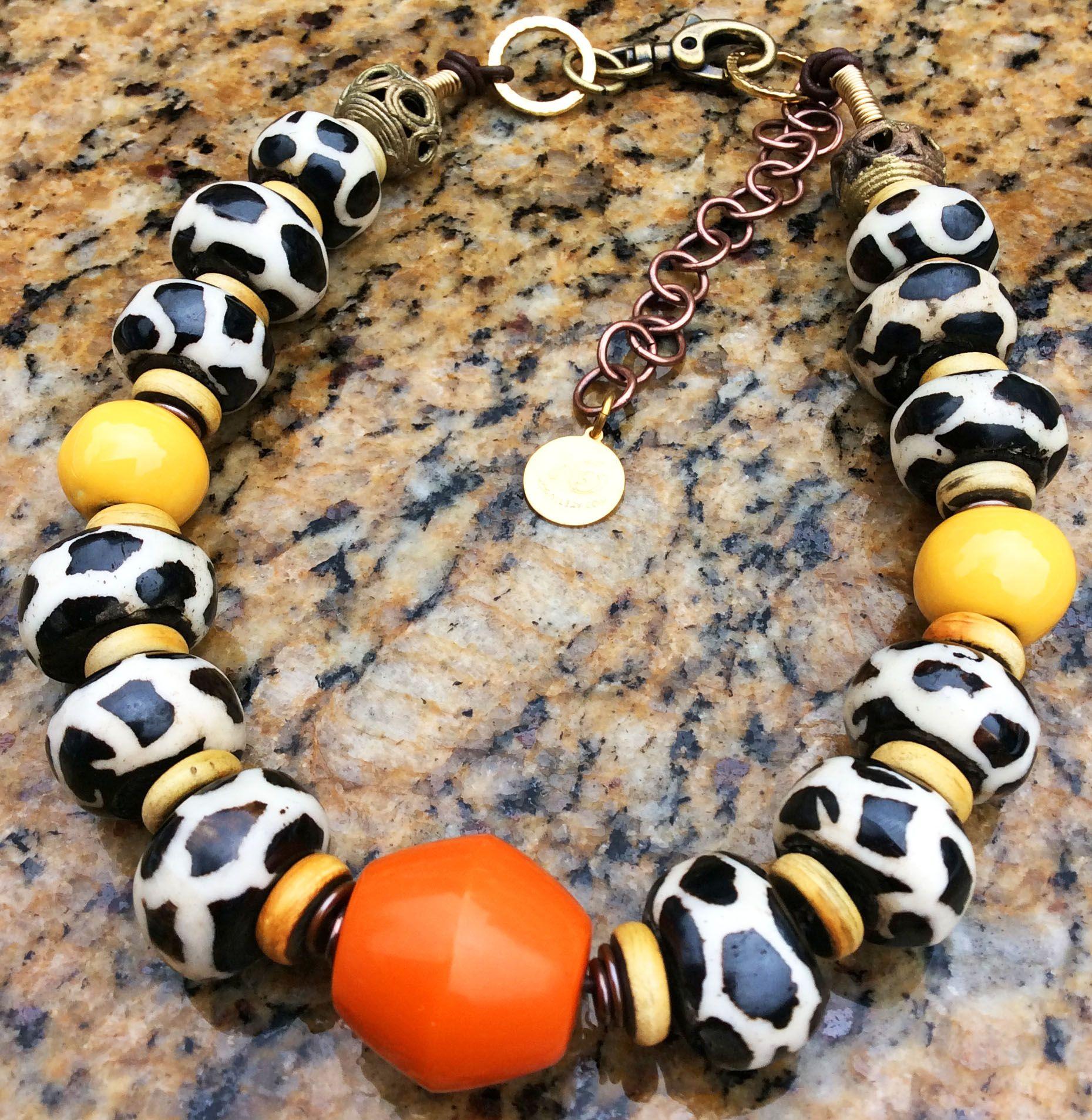 Twiga: Giraffe Print Bone, Orange Resin and Yellow Terra Cotta Necklace $250