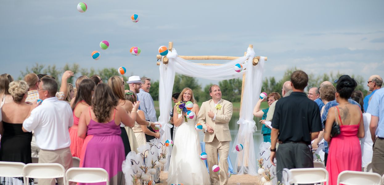 A Beach Wedding In Colorado Guests Throwing Mini At The Bride And Groom