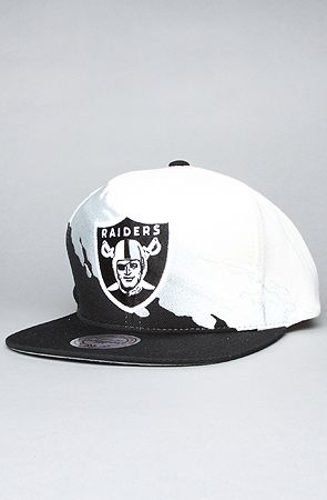 5c2c233acf1 The Oakland Raiders Paintbrush Snapback Hat in Black by Mitchell ...