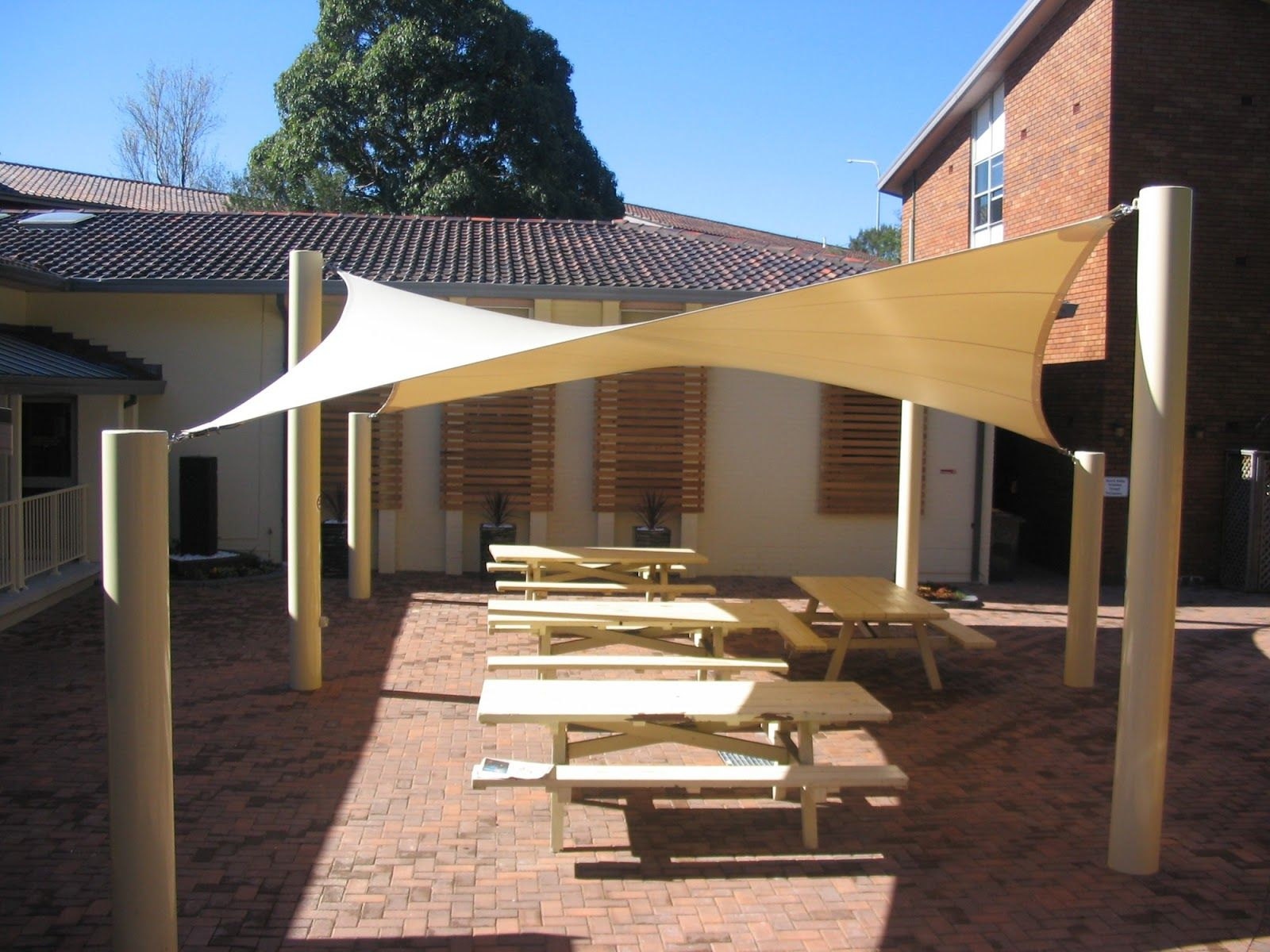 exterior white canvas pool shade with relaxing patio chairs decors - Brick Canopy Decor