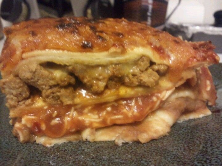 Mexican Lasagna....it has two layers of meat, the cheesy sauce is just covering the bottem meaty layer :) turned out great!!!