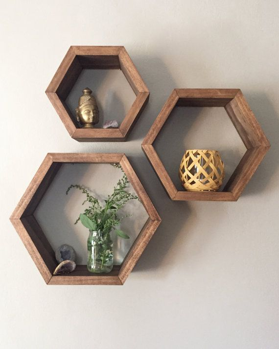 Set of 3 Hexagon Shelves with Rose Gold Interior is part of Living Room Shelves Gold - Handmade hexagon shelves crafted from select pine wood and finished with a walnut stain and rose gold interior  The shelves can be mounted to the wall or freestanding on tabletop surfaces  Great for displaying small plants, candles, pictures, and jewelry! One set includes three shelves and three mounting brackets (ships detached from shelves)     Small 7 75  wide by 3 5  deep     Medium 9 75  wide by 3 5  deep    Large 12  wide by 3 5  deep  Free local pickup in the Twin Cities, Minnesota area  If interested in picking up please message us for details  If you have any questions feel free to send us a message!