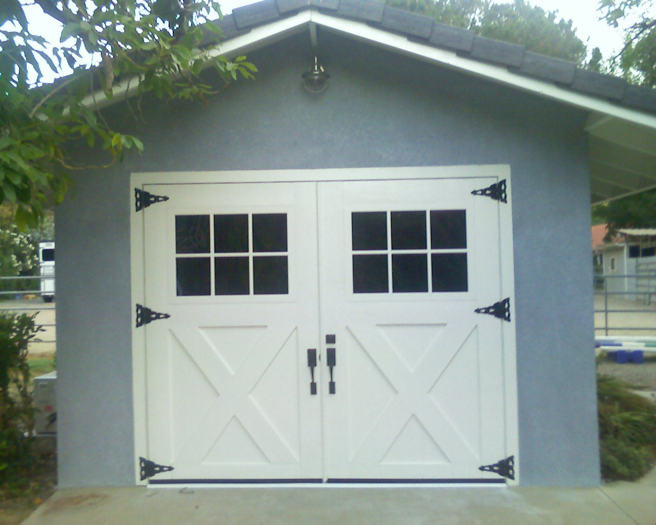 Carriage house doors perfect for bicycle house house for Coach house garage prices