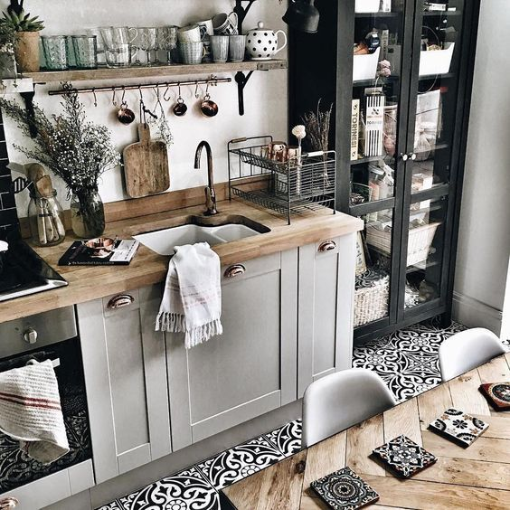Nice kitchen design with grey cabinets, wood tabletop and open wood shelve