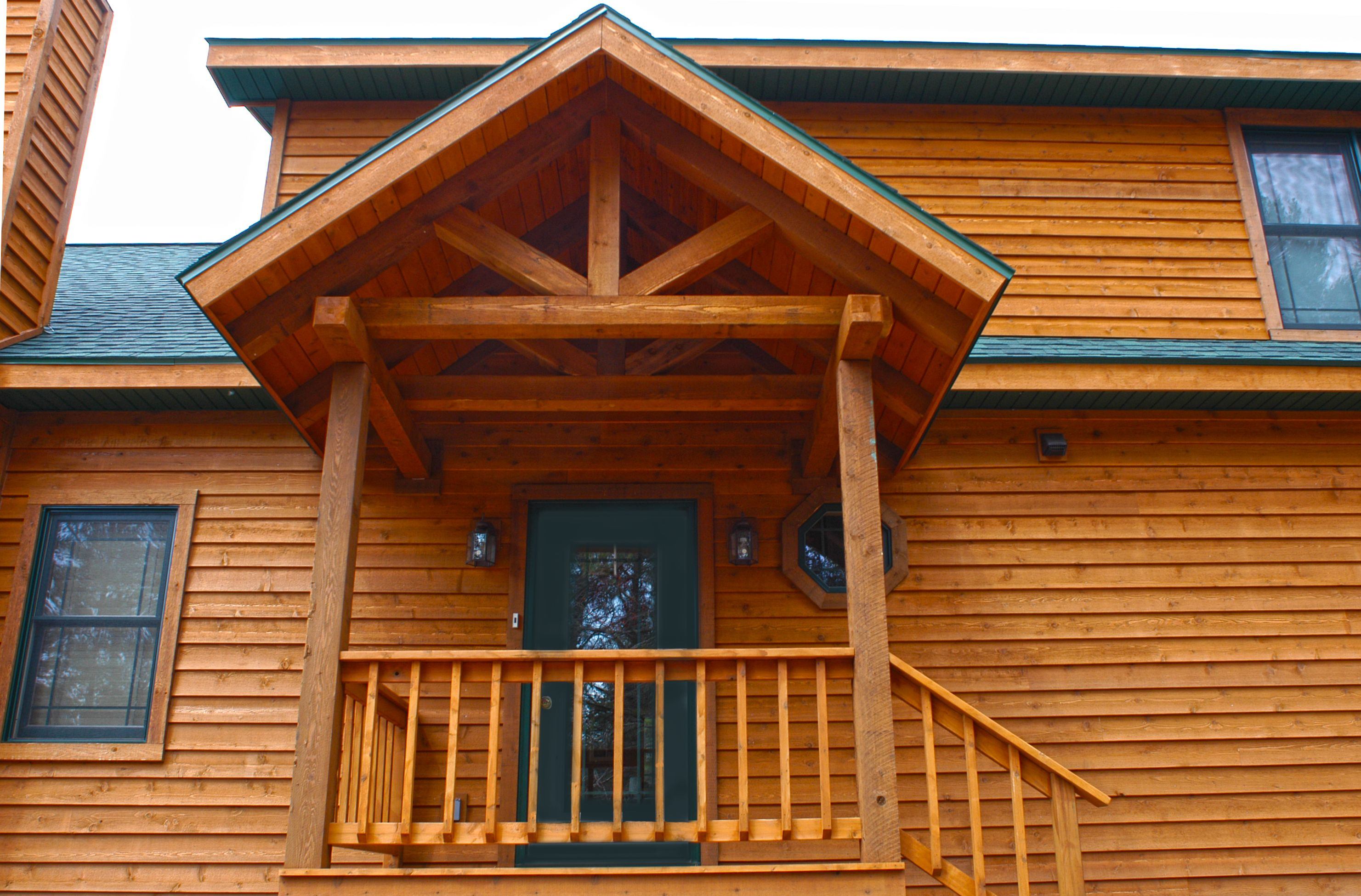 Timber Truss Covered Porch With A Cedar Ceiling Hybrid