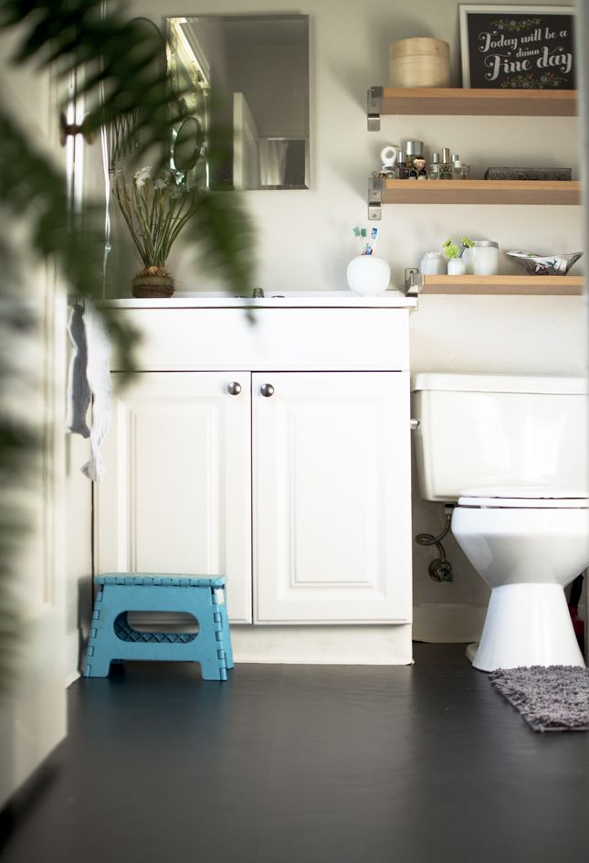 The Plumed Nest Apartment Fixes Mini Bathroom Make Over Black Bathroom Floor Apartment Therapy Small Spaces Bathroom Vanity Makeover