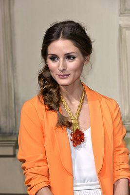 Olivia Palermo keeps it polished with an undone hairstyle.