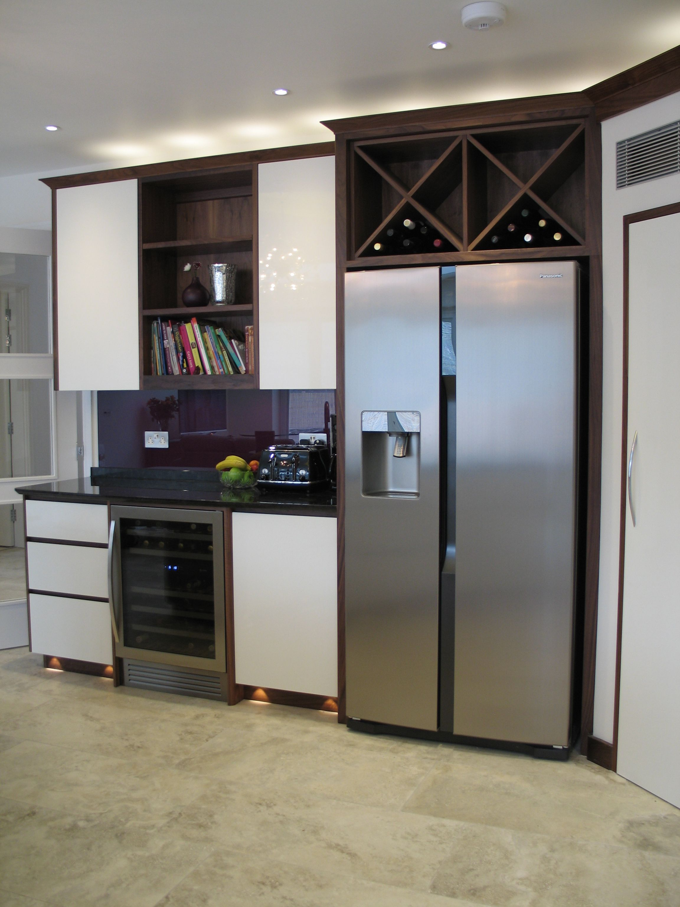 The fridge run. With fridge freezer and wine cooler, loads of storage and a stunning purple glass splashback. Take a look at our website for more eyecatching designs.