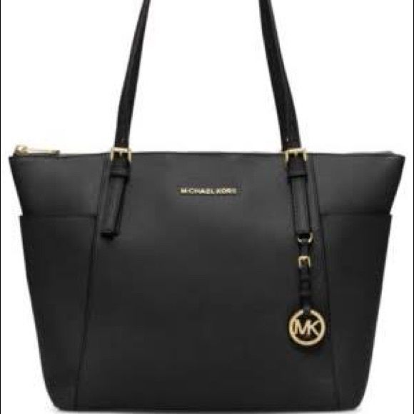 Michael Kors Purse AUTHENTIC AND BRAND NEW. NEVER USED. It is a shiny black 15c4447d51bf7