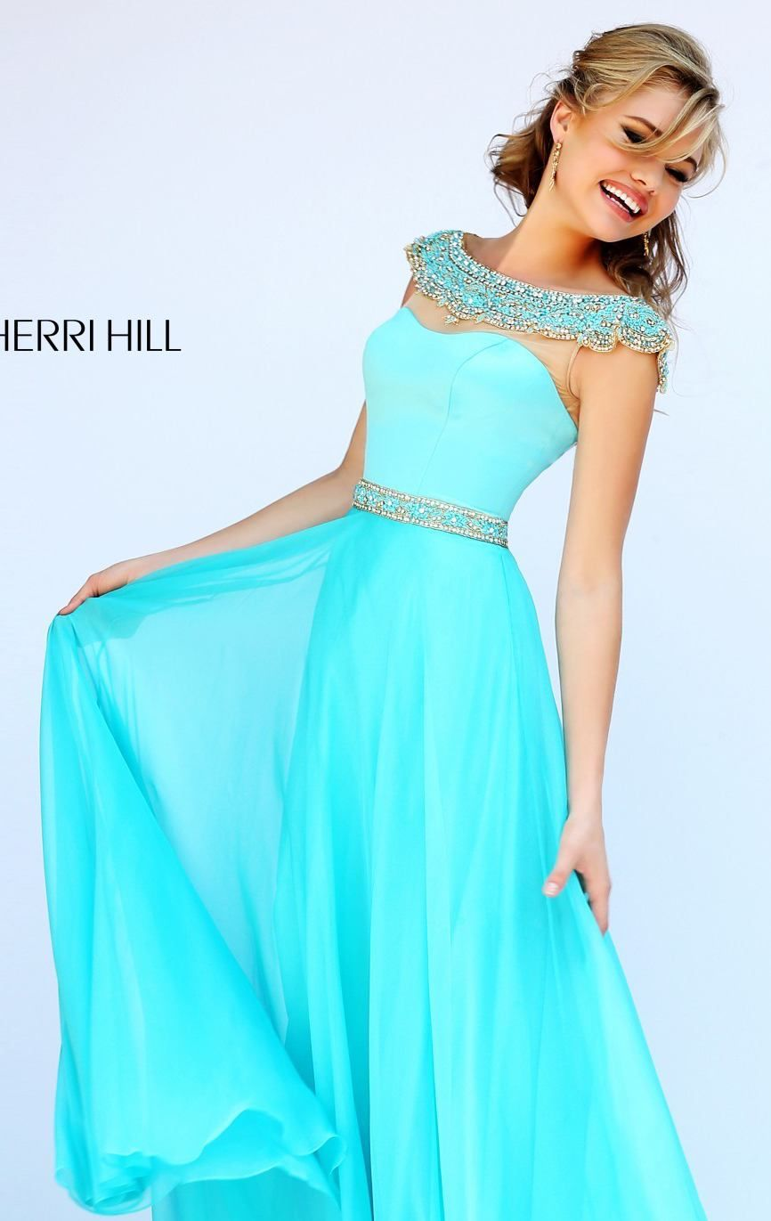 Look phenomenal in Sherri Hill 32220. This charming evening gown features a beaded bateau neckline. Sheer fabric covers the top over curvy sweetheart bodice. The slim band of luxury beadwork traces the fitted bodice. The skirt effortlessly sways as you gracefully dance on the floor.