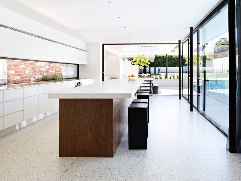 From the Brighton Home - I love the idea of a polished concrete kitchen bench + floor.  Lovely glazing too.